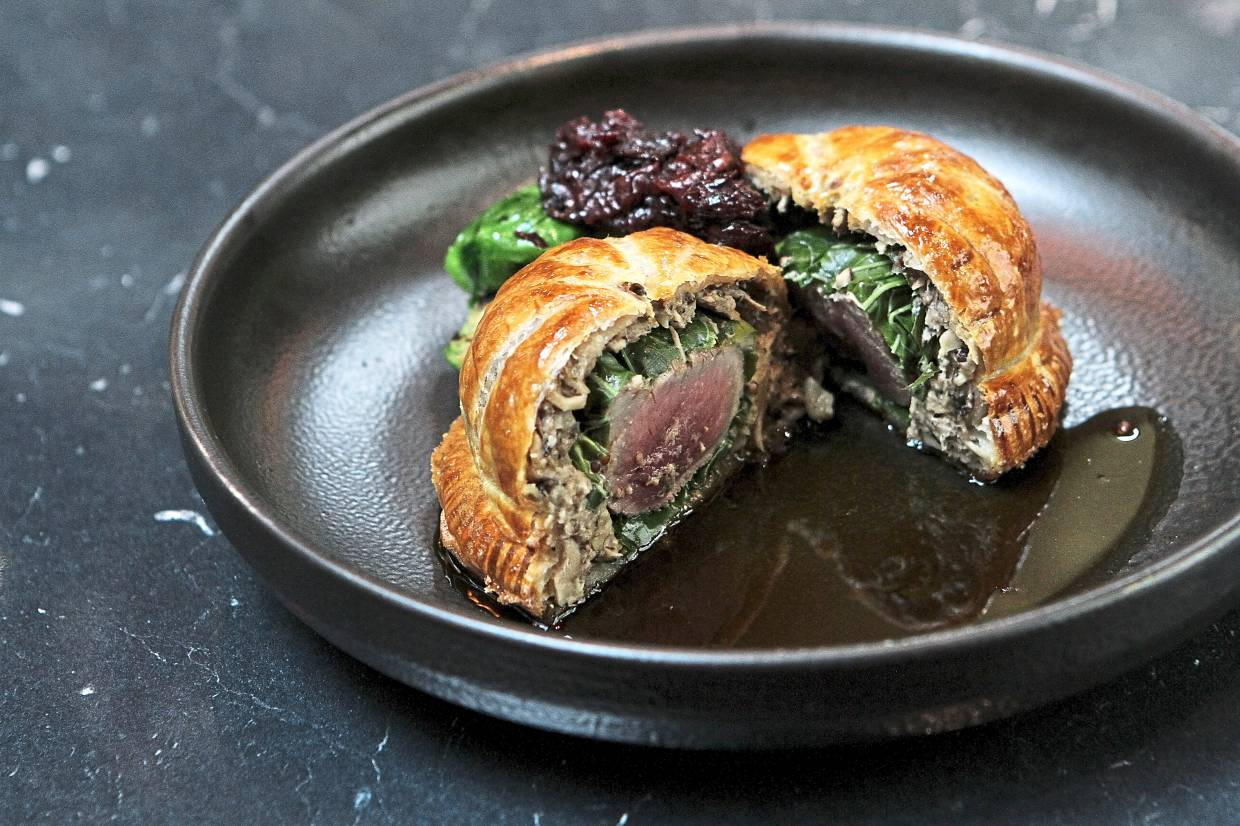 The venison pithivier features delightful pastry but the venison itself is a tad dry.