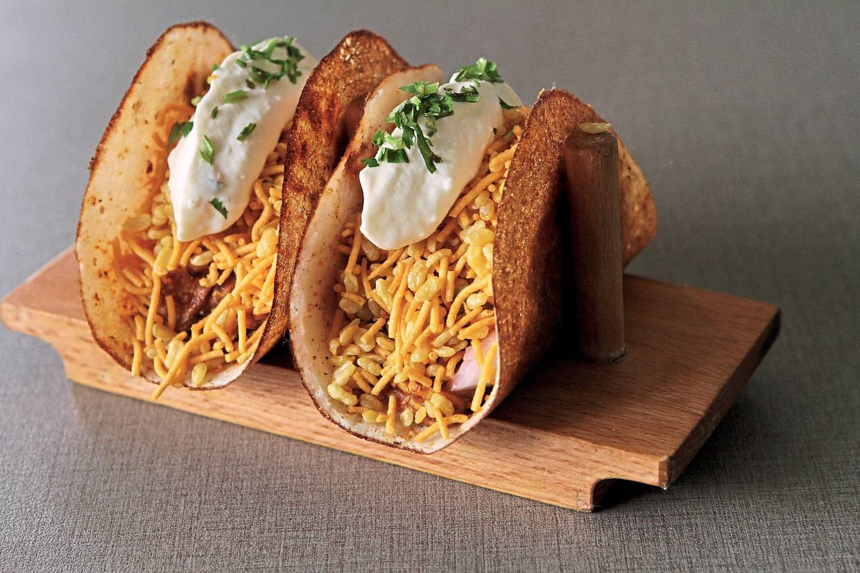 The dosa tacos offer an inventive take on tacos using dosa batter in place of tortilla shells.