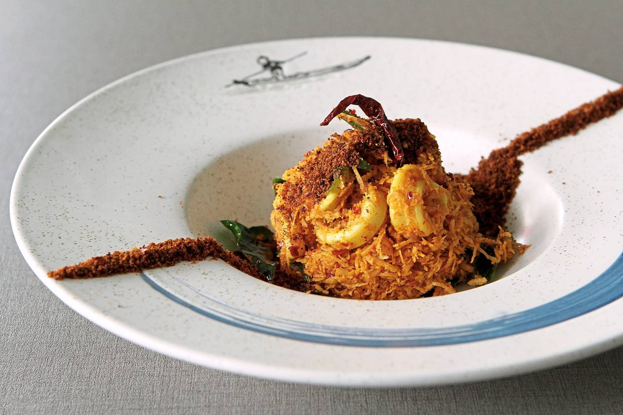 Crunchy grated coconut and tender squid coalesce perfectly in the squid pera chamandhi.