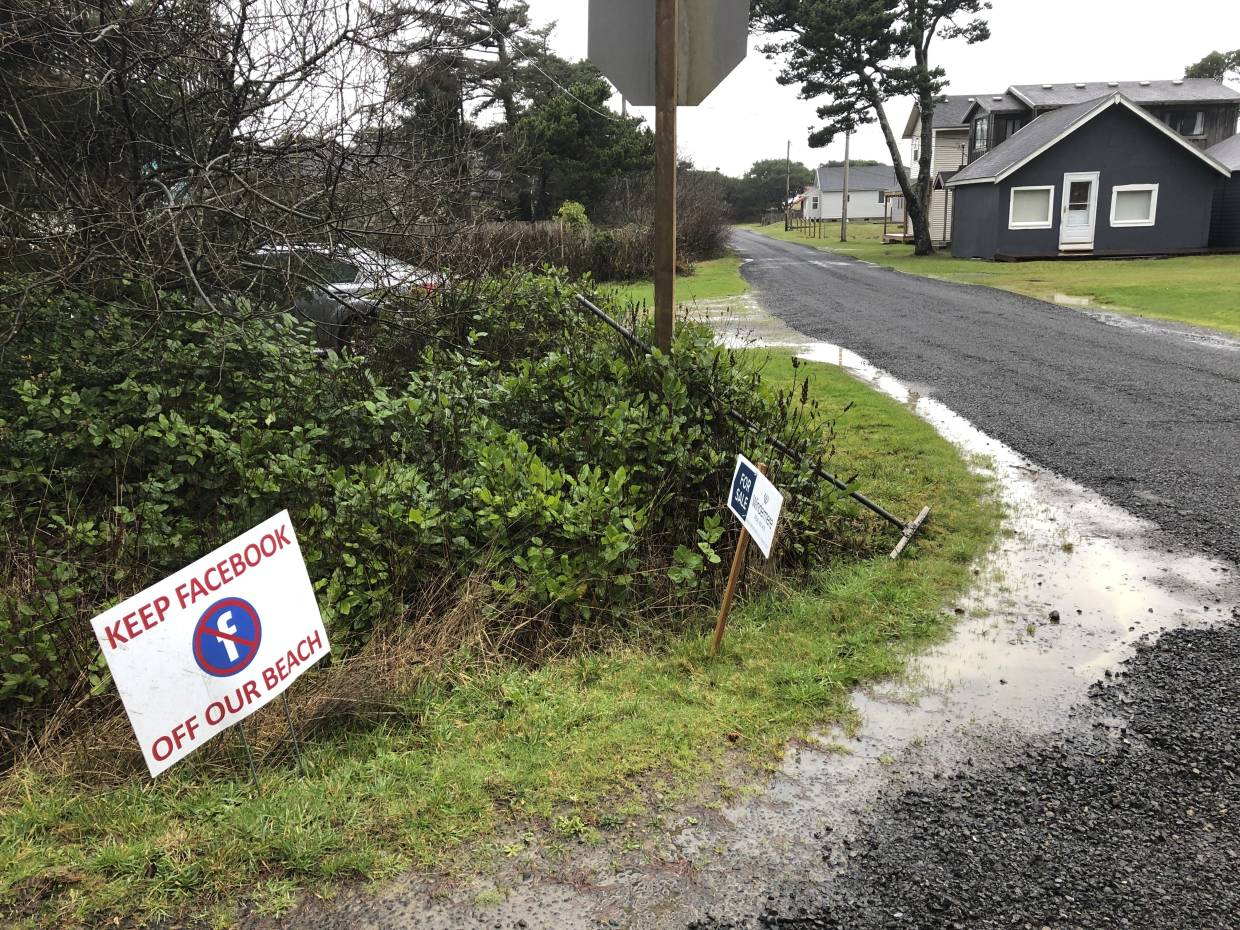 A sign expressing opposition to a plan by Facebook to build a landing spot for a submarine cable connecting America with Asia stands on property in the tiny community of Tierra del Mar, Oregon.