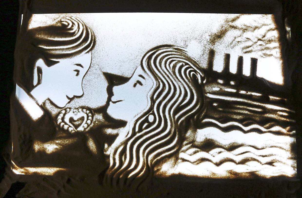 Sand art depicting scenes from the movie 'Titanic'.