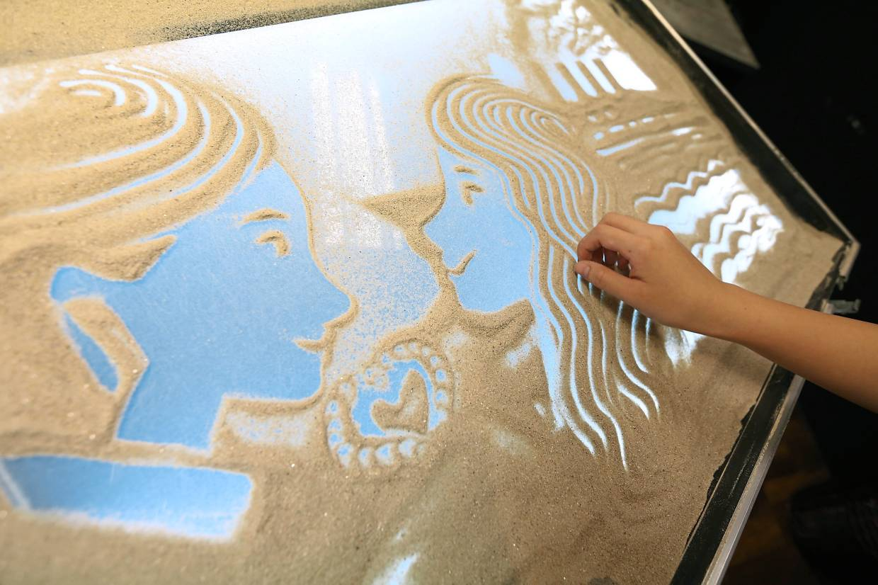 A sand artist has to work very fast with his or her hands to ensure a smooth transition of visuals during a performance.