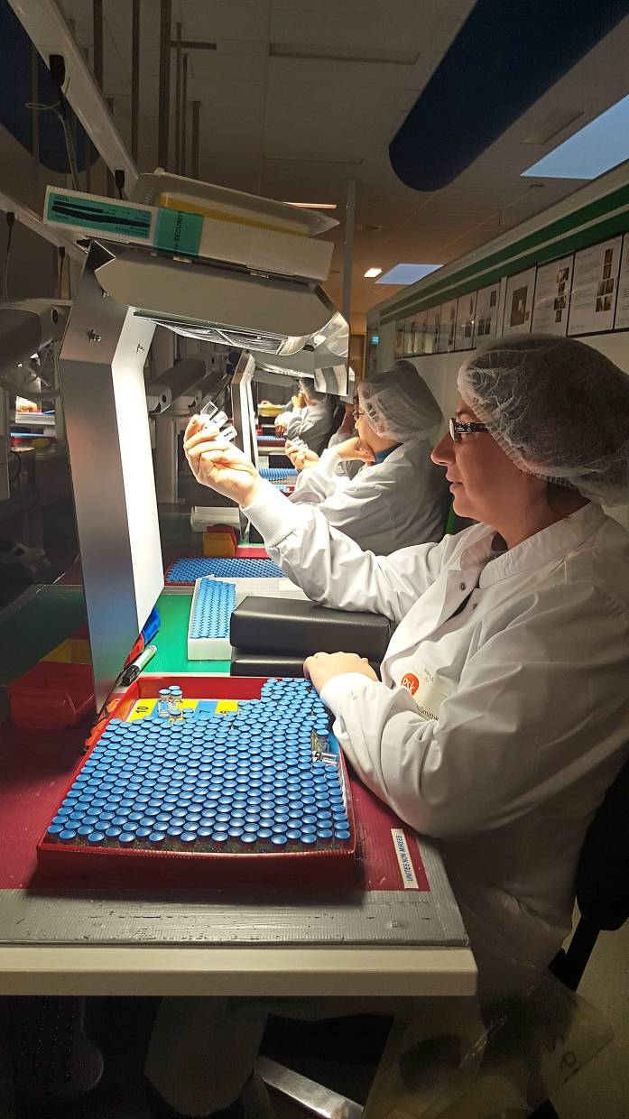 Visual inspection of the vaccines is one of the over 100 checks done throughout the manufacturing process. — Photos: GSK