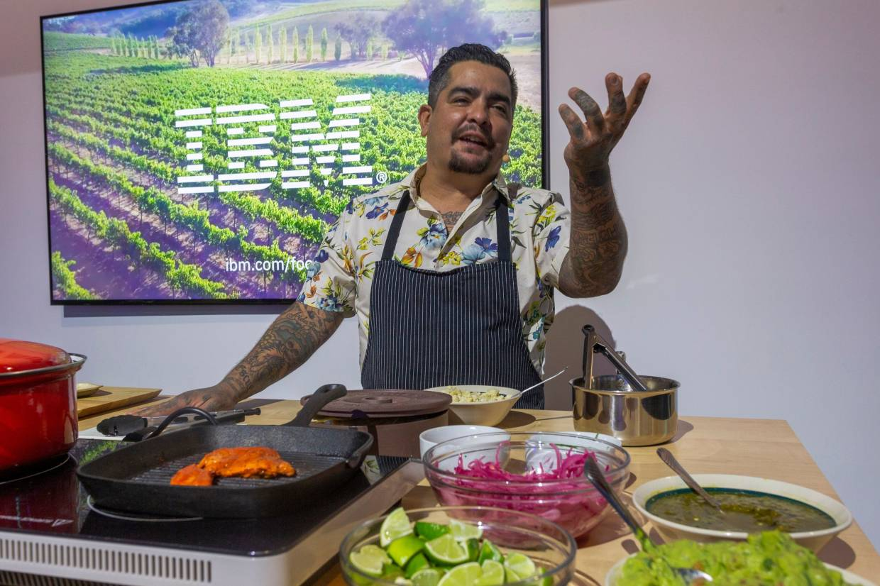 Chef Aaron Sanchez talking about blockchain technology to track foods while preparing tacos at the IBM exhibit at the 2020 CES in Las Vegas, Nevada. — AFP