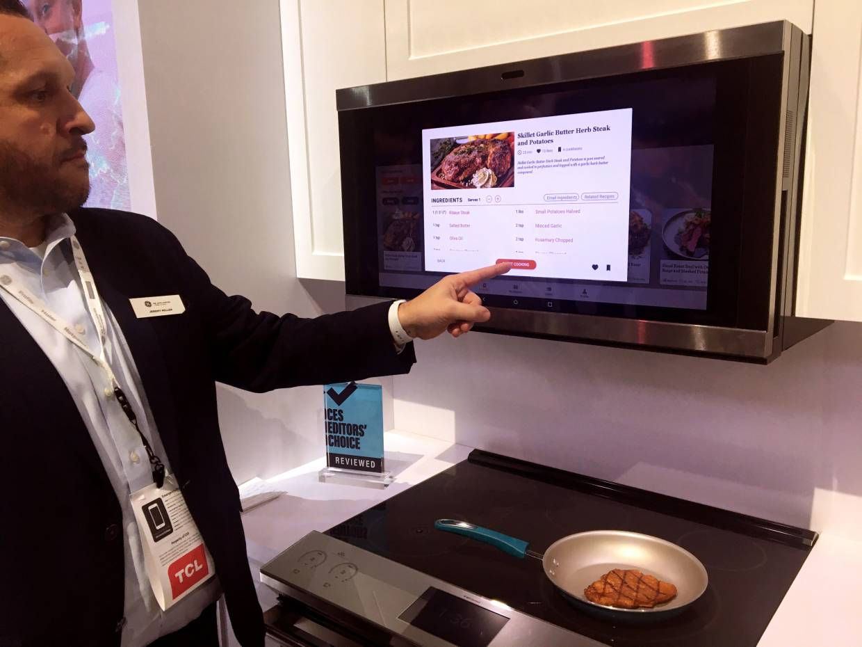 Miller showing a GE smart hub which uses AI to help consumers with meal planning and preparation at the 2020 CES in Las Vegas. — AFP