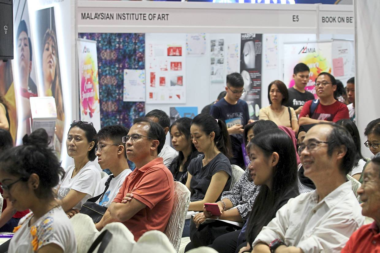 Visitors listening attentively to one of the talks.