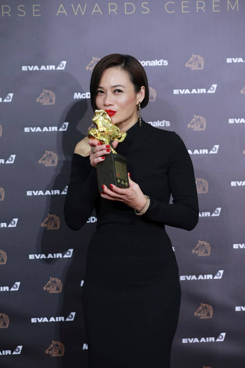 Yeo Yann Yann with her trophy at the Golden Horse Awards in November. Photo: AFP