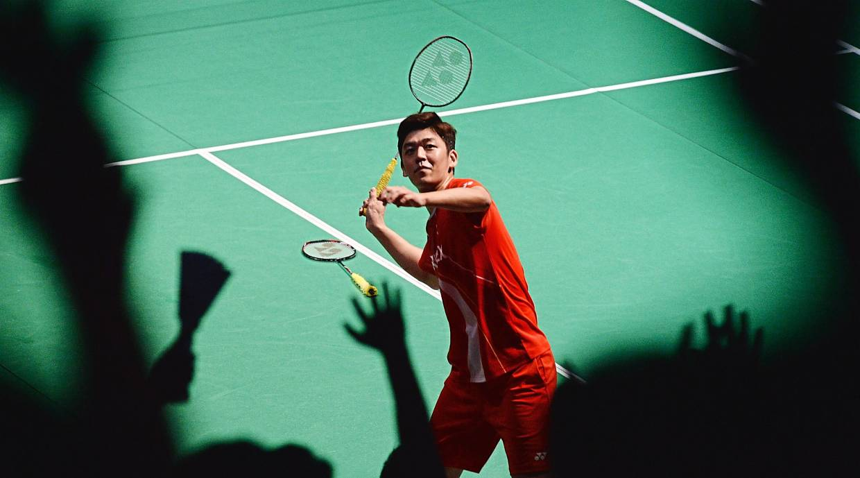 Catch it if you can: South Korean men's doubles player Lee Yong-dae throwing his racquet to the crowd after he and partner Kim Gi-jung beat Li Junhui-Liu Yuchen of China in the final yesterday.