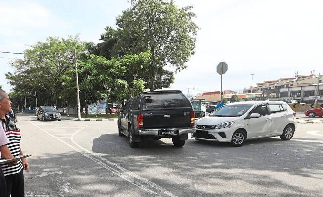 Motorists commonly make an illegal right turn here like the driver of this white car.