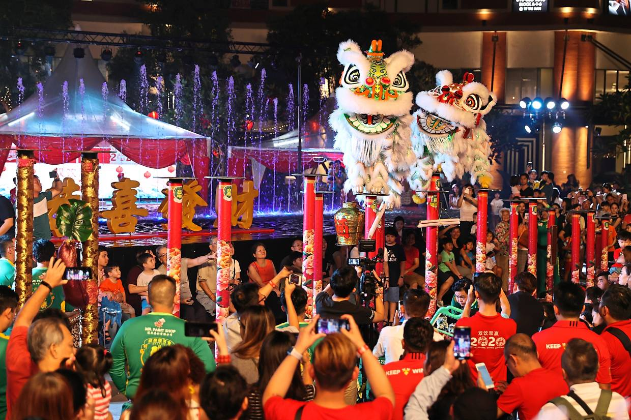 More than 350 guests being treated to a spectacle of lion dances, tasty food and free flow of beer during Carlsberg's Chinese New Year 2020 campaign launch in Desa Park City, Kuala Lumpur.