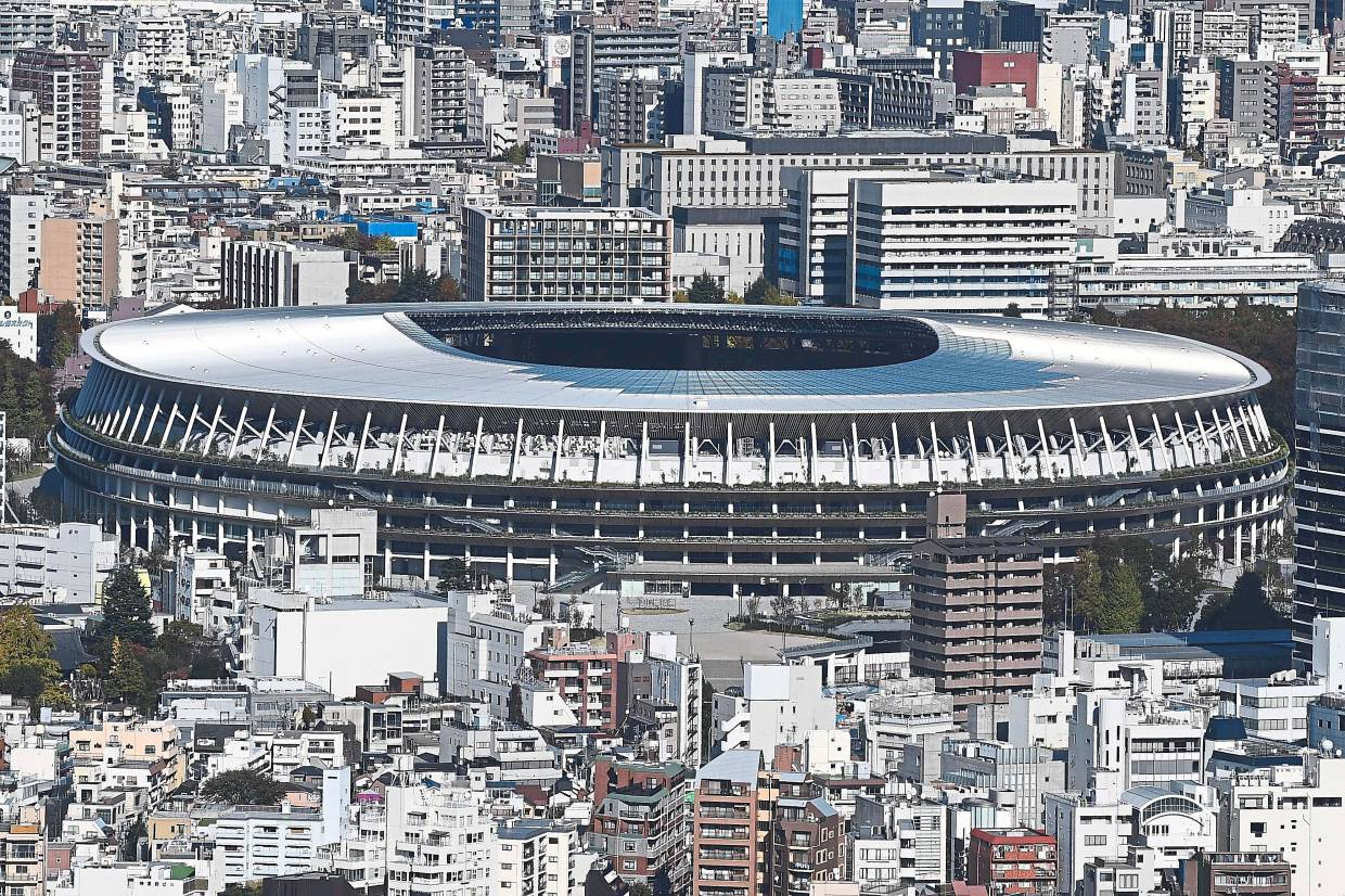 The new USD$1.4bil main venue for the 2020 Tokyo Olympic Games is pictured after being officially completed in Tokyo on Nov 30,2019. The five-story stadium, designed by Kuma, will seat 60,000 fans. — AFP