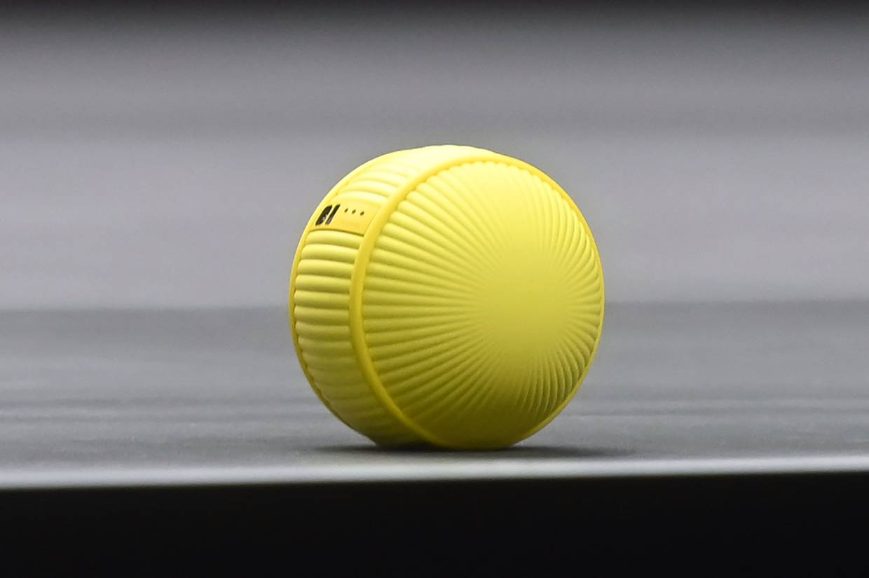 Ballie, a round yellow life companion robot that can react and interact with its owner, at the 2020 CES in Las Vegas, Nevada. — AFP