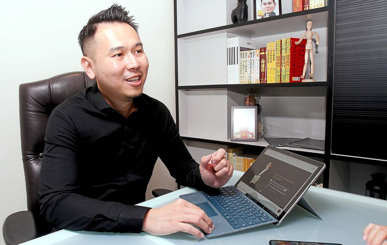 Technology has made his work easier, says Wong. Previously it took him days to draw a Bazi chart by hand but now he can create one with an app in just seconds. — SHAARI CHEMAT/The Star