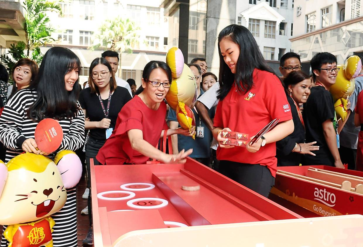 SMG employees participating in games organised by Astro at the Chinese New Year event.