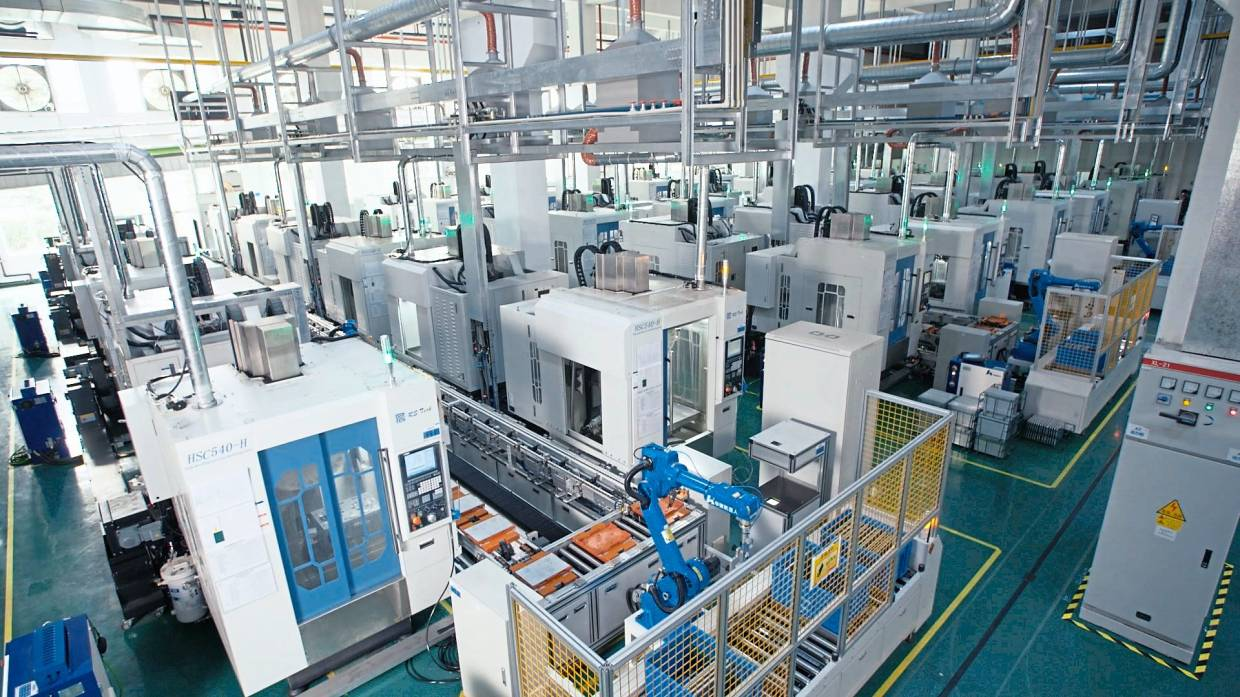 Robotic arms in the assembly line in Suzhou Victory Precision Manufacturing Co Ltd factory. Suzhou is one of nine cities in China president Xi Jinping Yangtze River Delta G-60 Valley project.