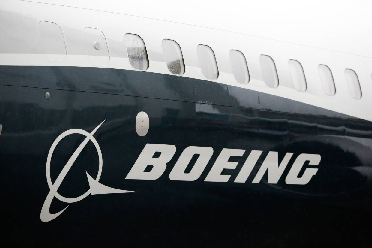 Fitch cuts Boeing's credit rating on doubts over return of 737 MAX