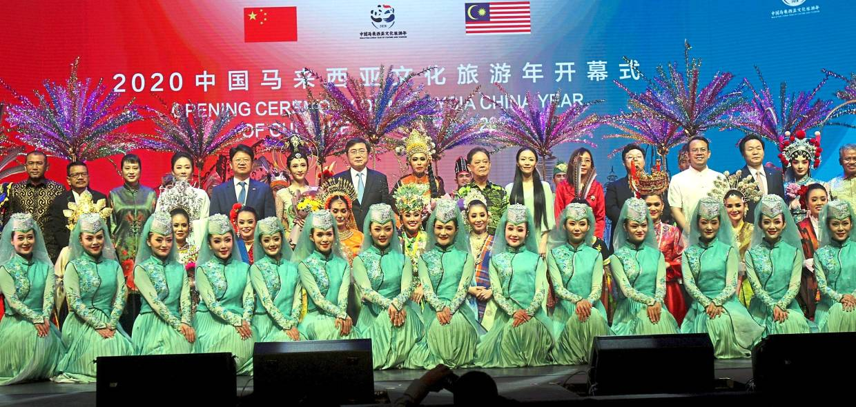 Best of both countries: The guests of honour with dancers from both countries on stage at the end of the opening ceremony at Istana Budaya.