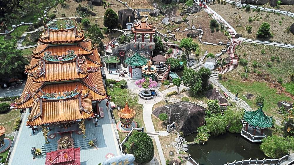 Worth a thousand words: An aerial view of the Taoist temple Fu Lin Kong, which boasts a mini Great Wall garden. The island has an interesting mix of religious architecture to explore.