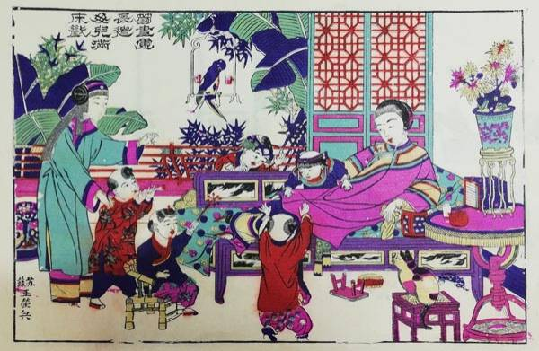 A Qing Dynasty Lunar New Year print features a mother with her kids, a production of Taohuawu in Suzhou, Jiangsu province.