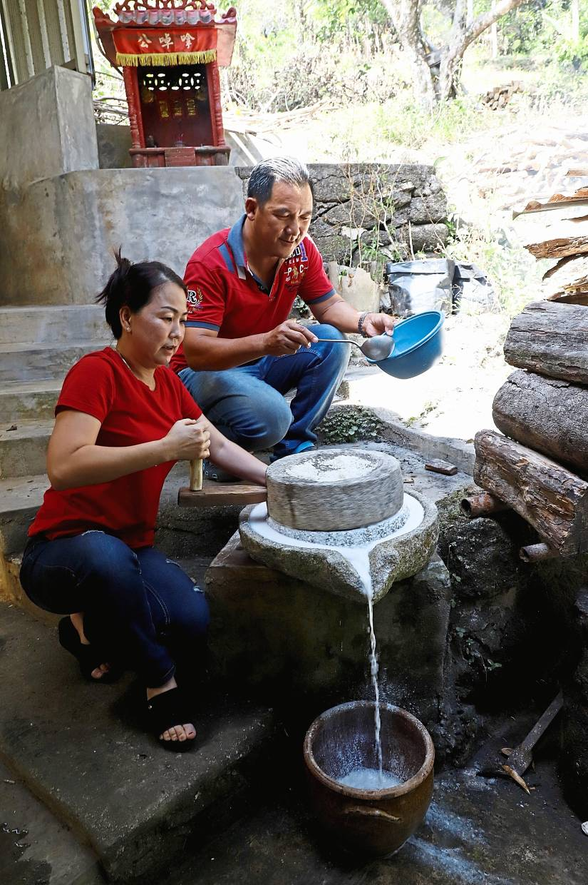 Kie and wife Shirley Koh, 45, pouring the batter into a container.