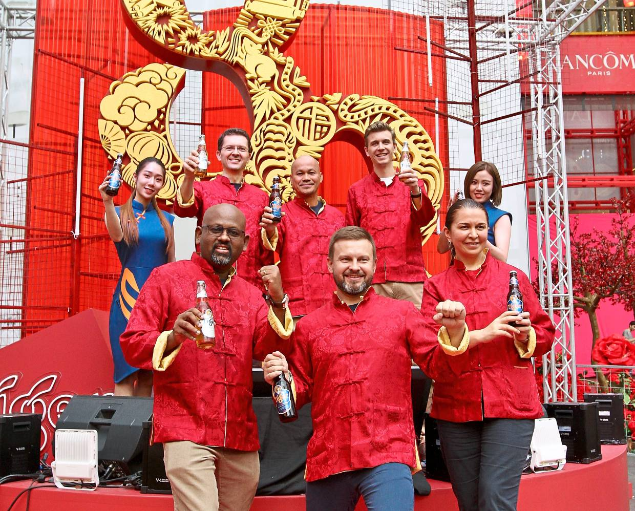 (Back row, from second left) Heineken Malaysia Bhd finance director Szilard Voros, Roland and marketing  director Pablo Chabot with (front row, from left) human resources director Kukarajan Kanagarajan, sales  director Vasily Baranov and supply chain director Salima Bekoeva at the launch of the Tiger Beer campaign.