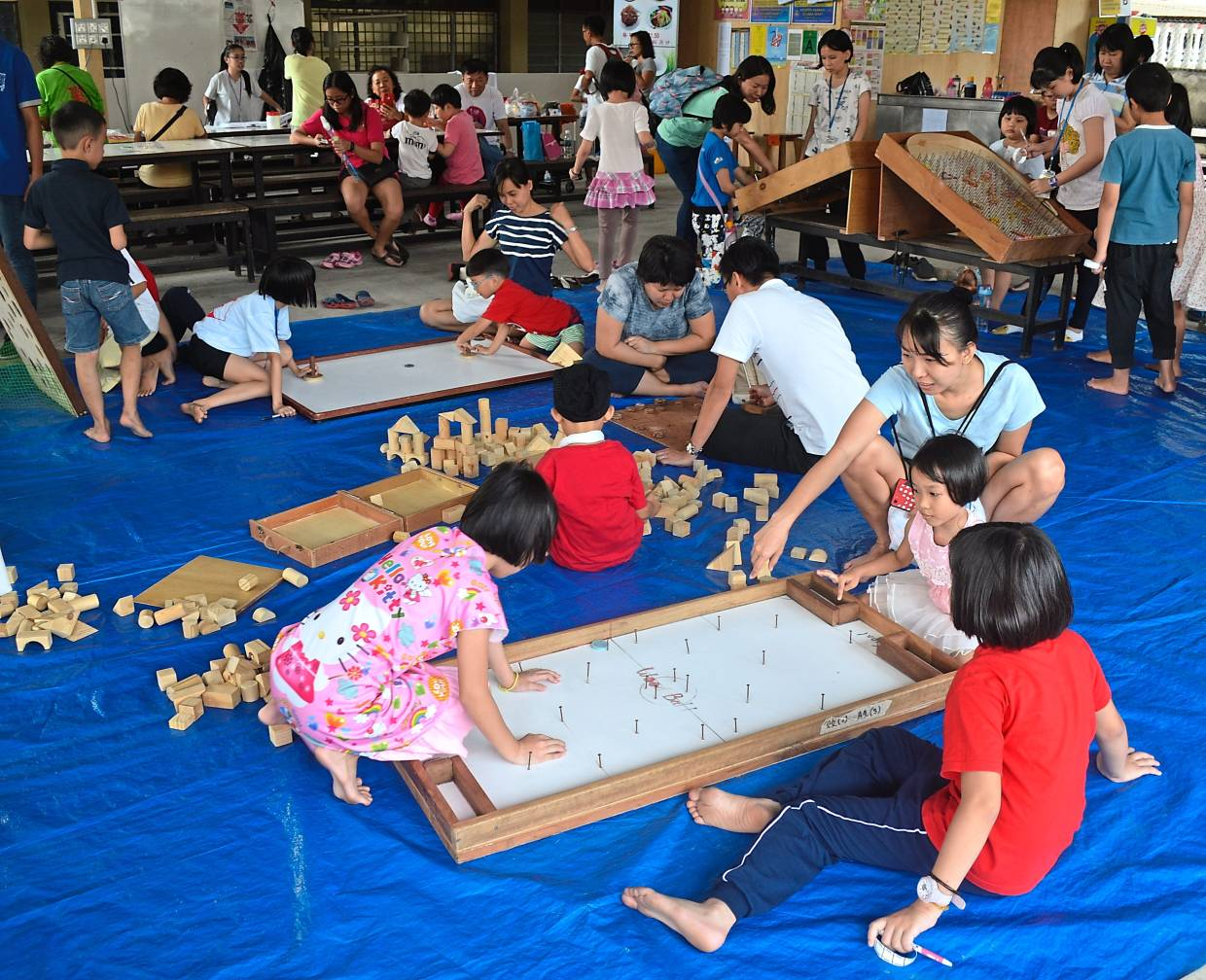 Children enjoying a game at the carnival.