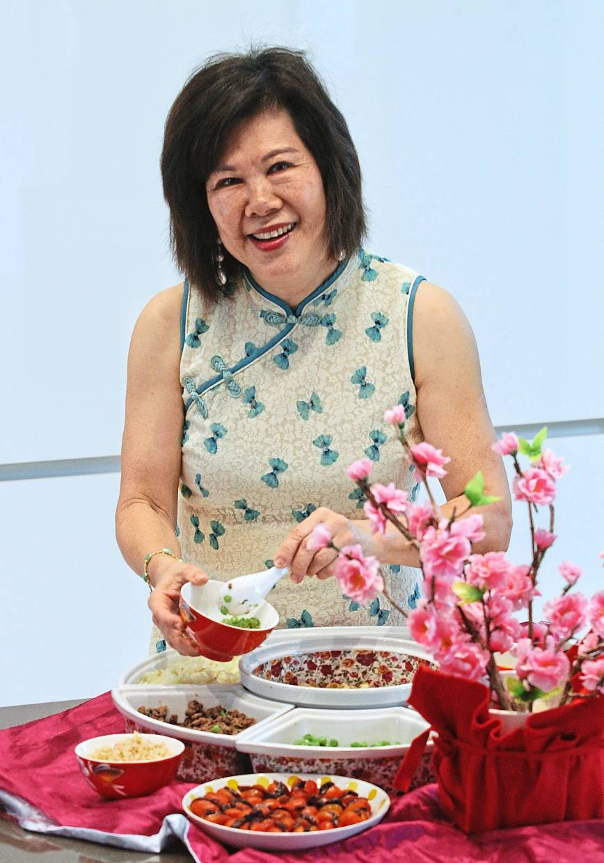 Tay is an energetic hostess who typically cooks for up to 200 people every CNY.