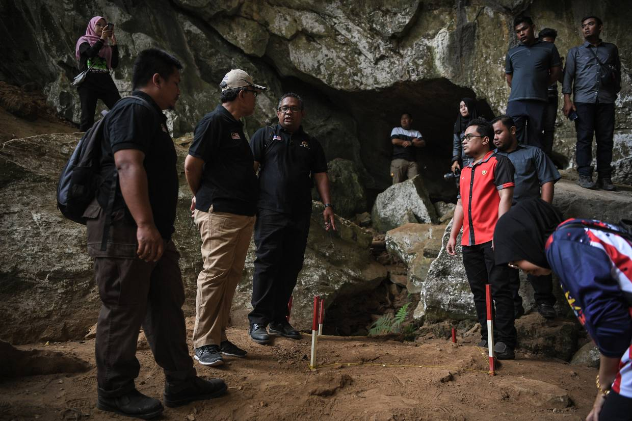 National Heritage Department Archaeological Division director Ruzairy Arbi  (third from left) explaining the finds to department director-general Mesran Mohd Yusop (second from left) during a visit to the site on Tuesday (Jan 21).