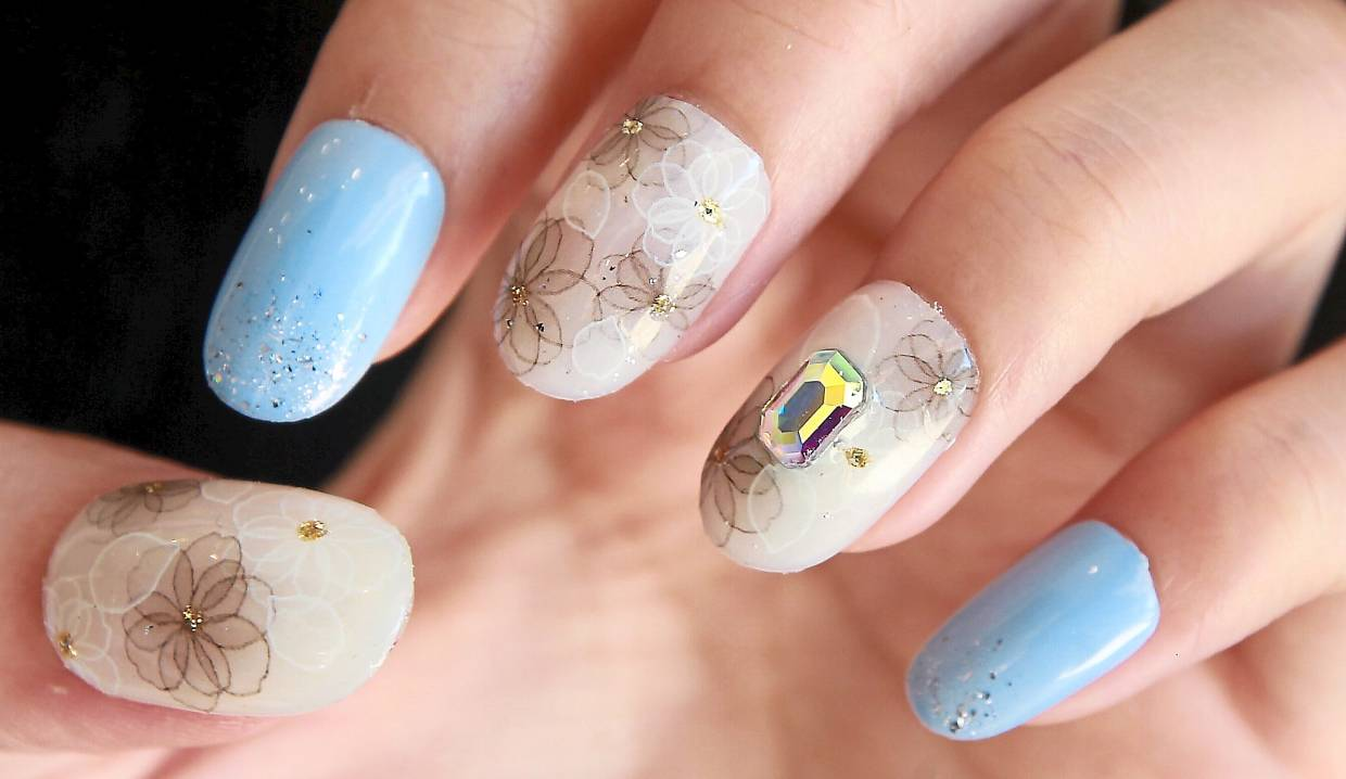 Nail artist Carmen Chee's floral design with a marble effect comes with blue accents as a tribute to Classic Blue, which was chosen as the Pantone Colour of the Year. — NORAFIFI EHSAN/The Star