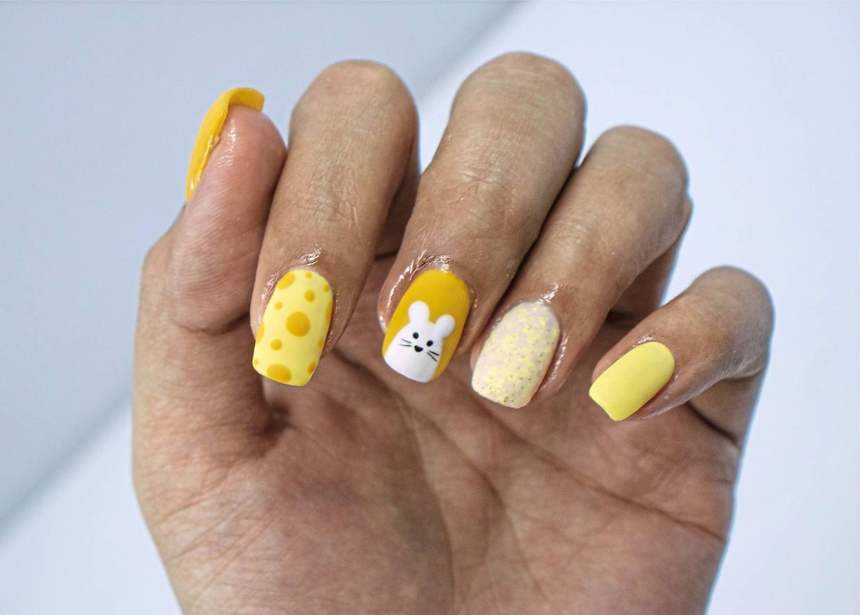 For this Year of the Rat design Jac & Ivy Nail Spa chose yellow instead of red to make a distinction, but at the same time, still bringing out the feeling of the festive season. — Jac & Ivy Nail Spa