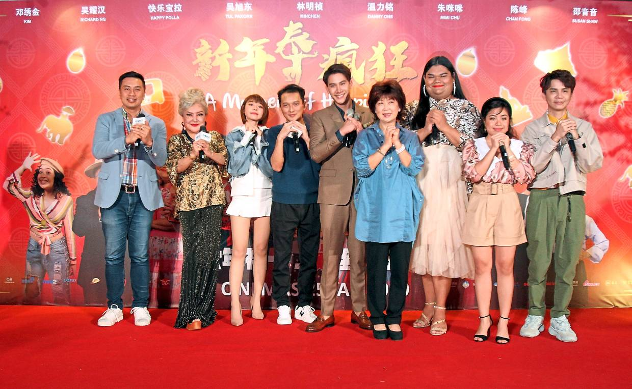 The cast members of 'A Moment Of Happiness' greeting fans at the movie premiere at MM Cineplexes in Petaling Jaya.