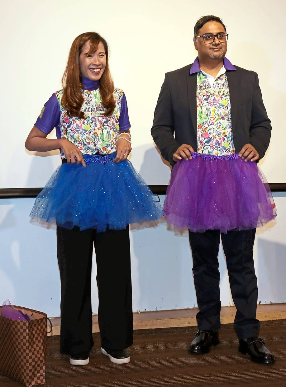 Loh (left) and Prasheem showing off the tutu that will be used during the marathon.