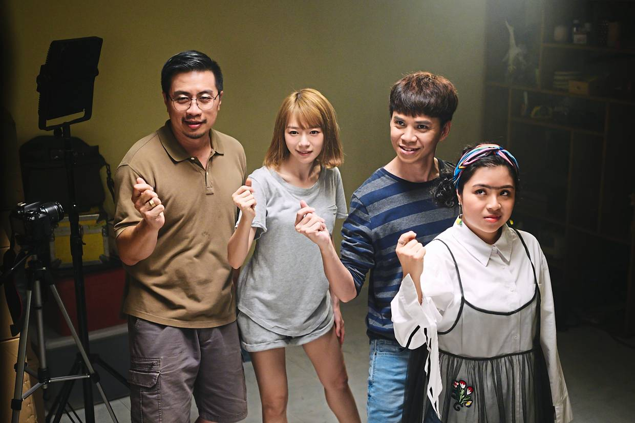 In A Moment Of Happiness, Lim (second from left) stars with Chan Fong (left) as her father, Danny One as her uncle and Thian Siew Kim (right) as her bestie.