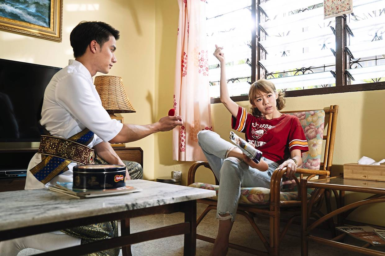 One of the hardest scenes to shoot for Lim is gripping a bag of snacks with her toes. In this scene is Lim's Thai co-star Tul Pakorn. Photo: Handout