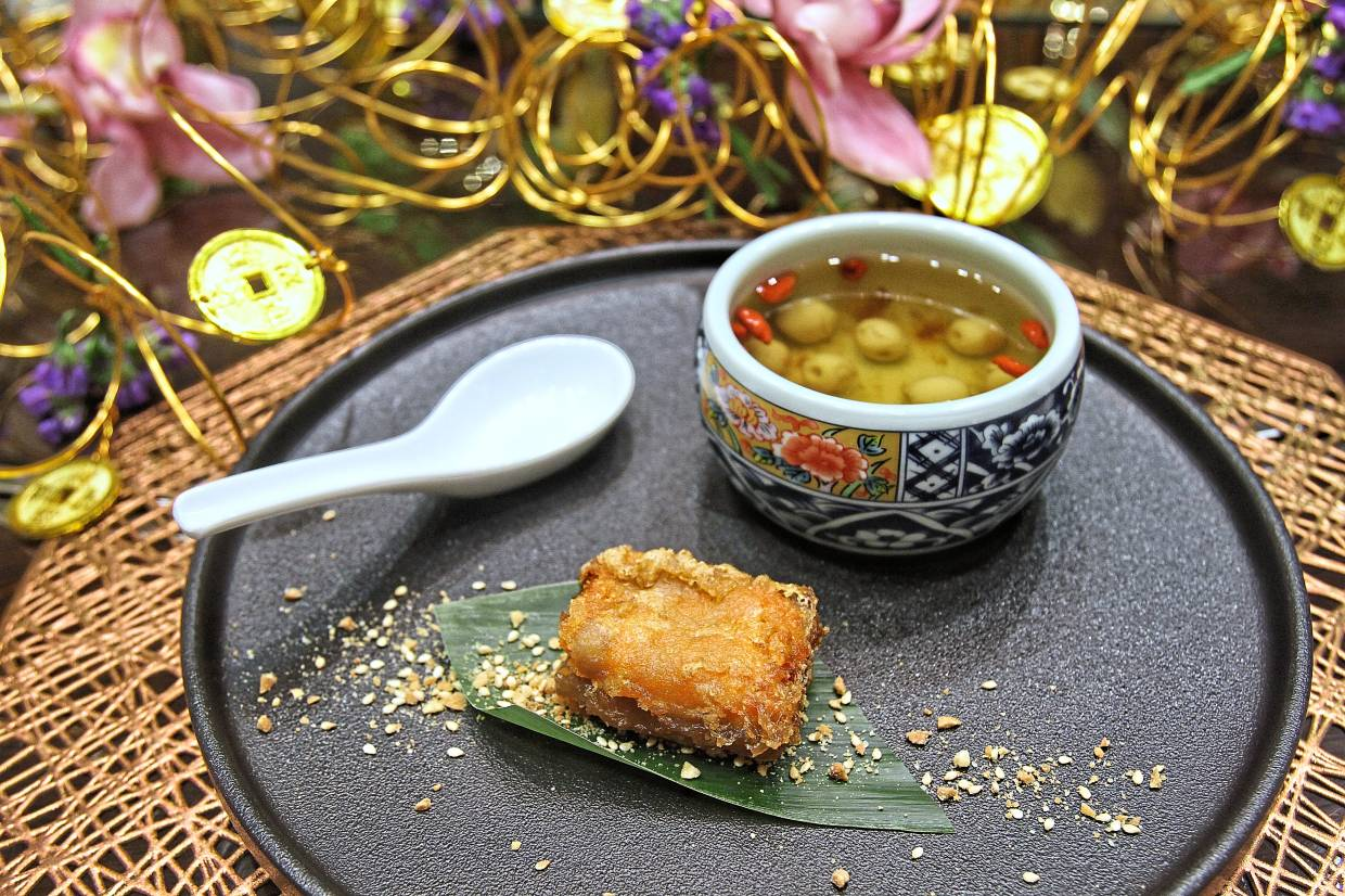 Deep-fried 'nian gao' with yam and sweet potato as well as lemongrass tea, peach gum and goji berries.