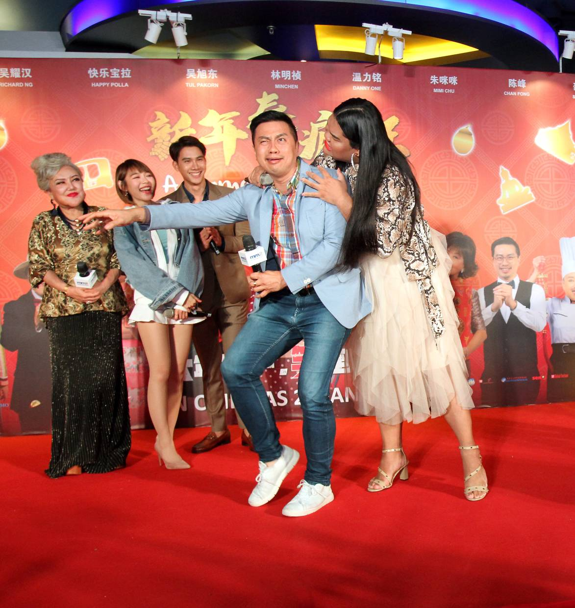 The cast of The Moment Of Happiness (from left) Shaw, Lim, Pakorn, Chan Fong and Happy Polla goofing around at the press conference for the movie. - The Star/Muhamad Shahril Rosli