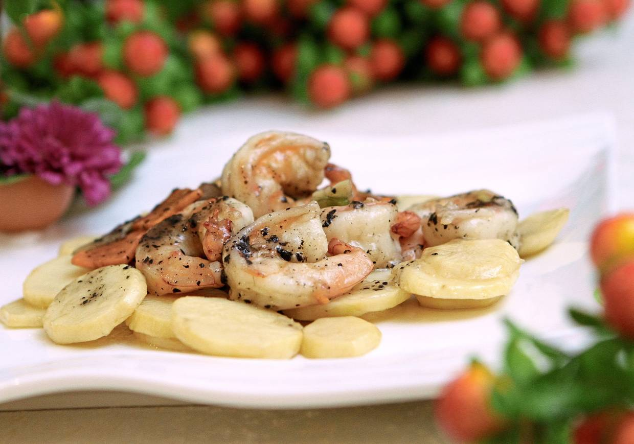 Sauteed Tiger Prawns with Truffle Sauce and Arrowroot.