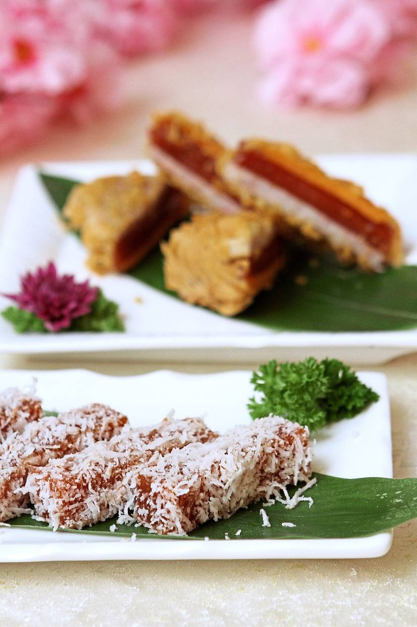 Nian gao, steamed with shredded coconut (front) and deep-fried with sweet potato and yam.