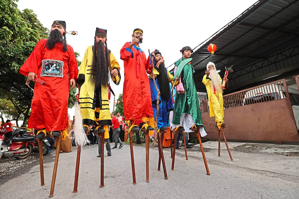 Stilt-walkers during the launch of the Fo Guang Shan Dong Zen Temple Lantern and Flora Festival.