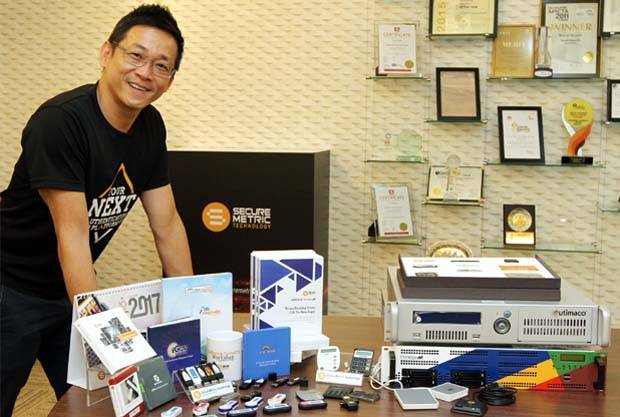 Edward Lau with some of the company's products