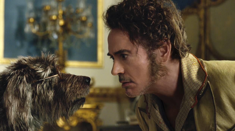 Dog Jip (Tom Holland) and Dr. John Dolittle (Robert Downey Jr.) in 'Dolittle', directed by Stephen Gaghan.