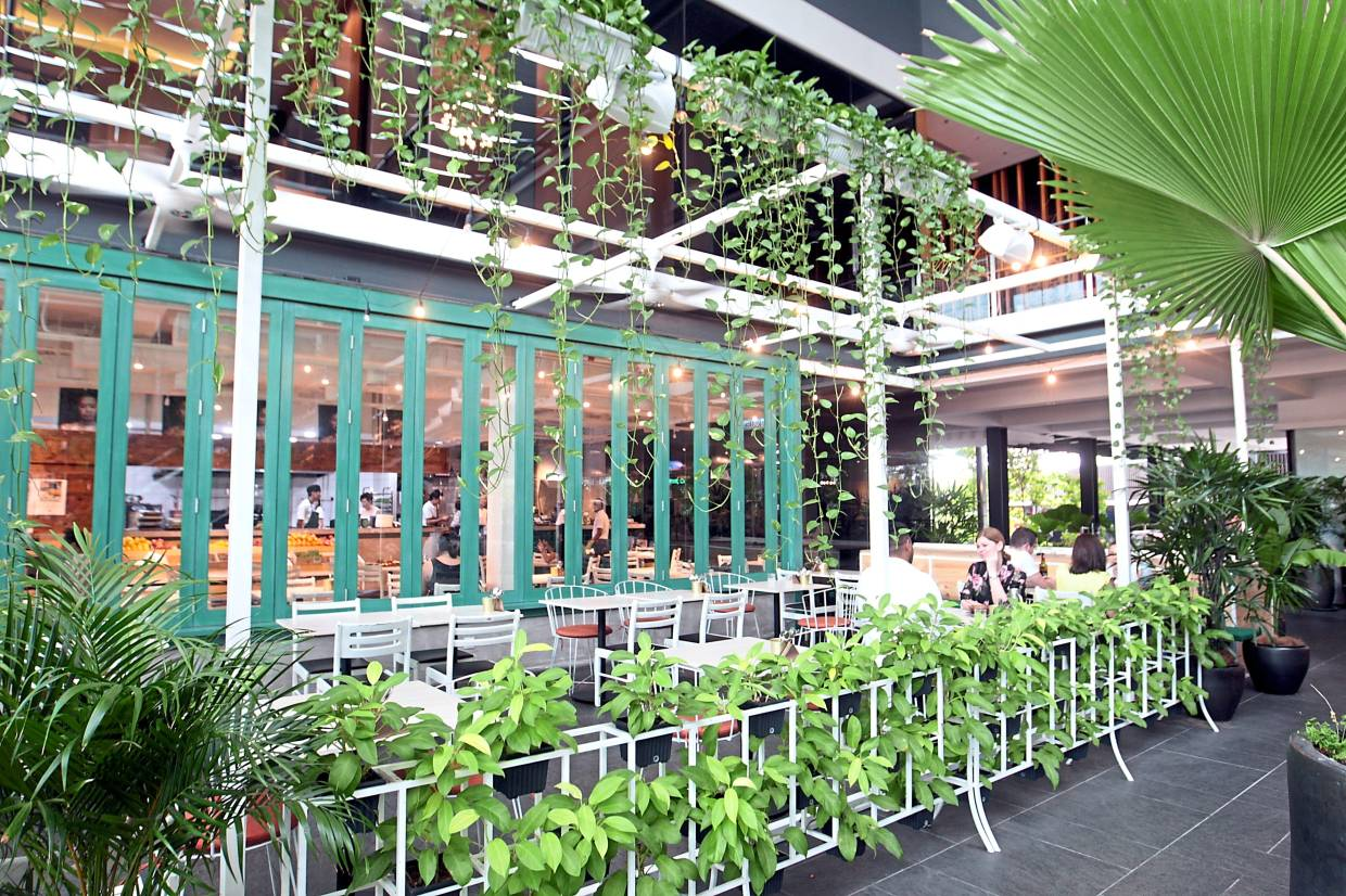 In keeping with its advocacy of plant-based foods, plants are scattered throughout the entrance of Parklife.