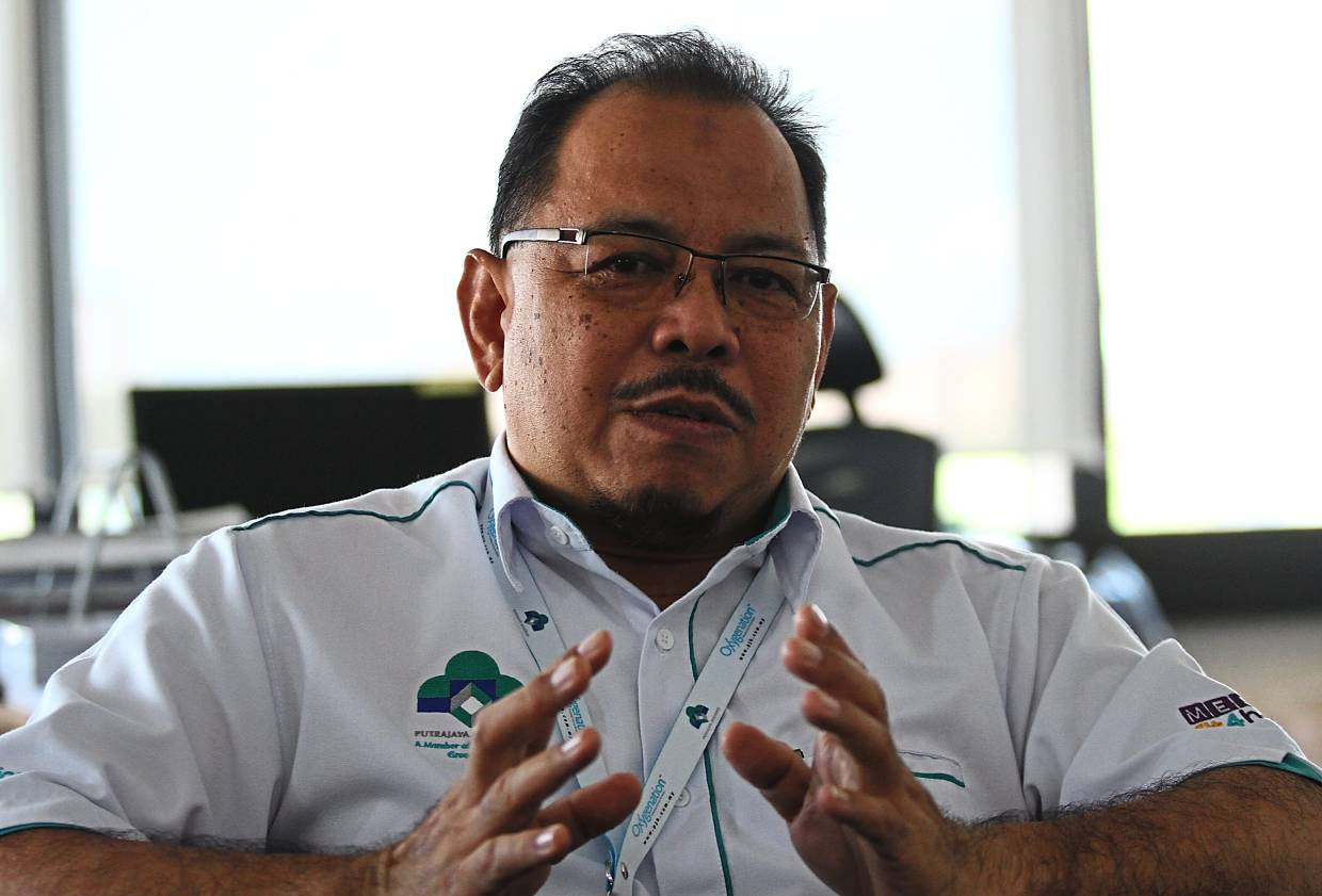 Mhd Zaini says relocating the ministries and staff first was important to speed up the growth of Putrajaya.