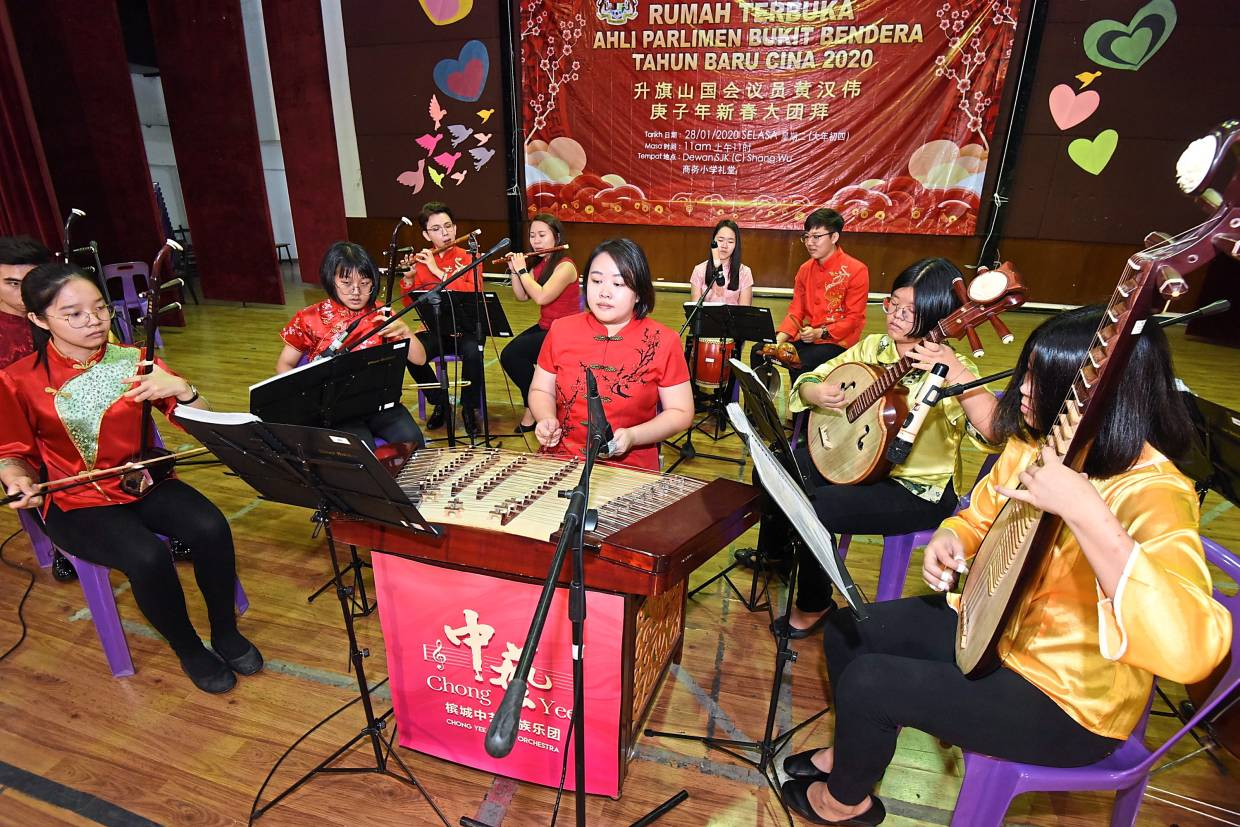 A Chinese orchestra entertaining guests.