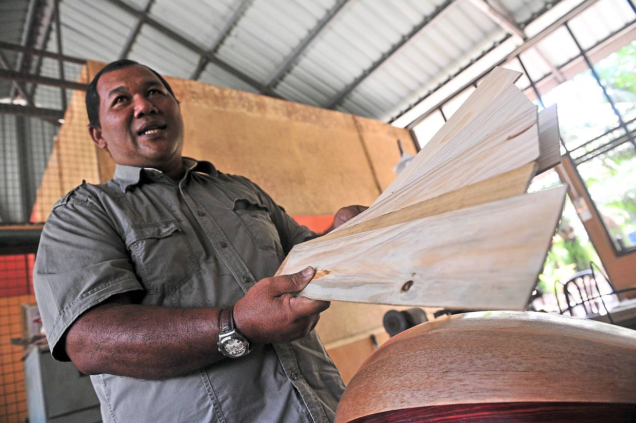 Halidan, who has been making the instrument since 2000, only uses locally-sourced wood such as that of the rengas and merawan trees or soursop or ciku (sapodilla) fruit trees. Photo: Bernama