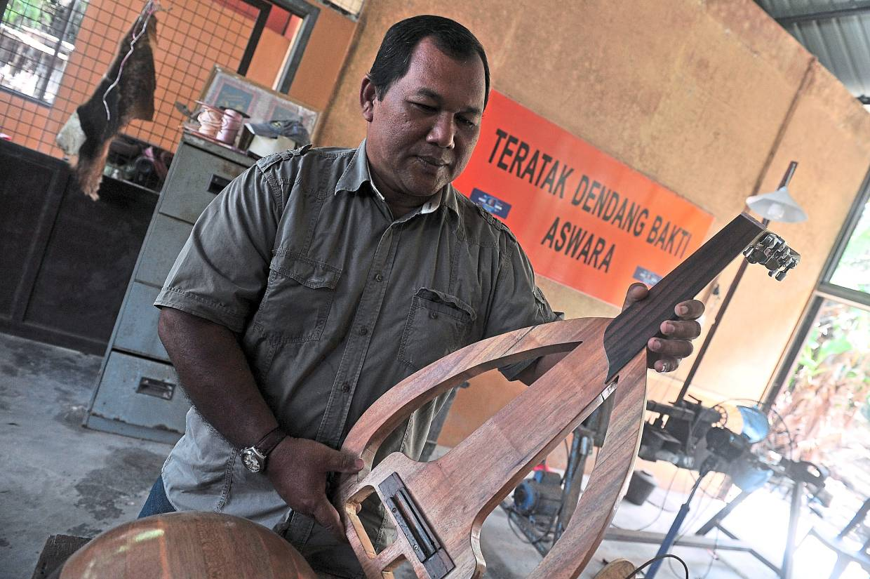 A handmade gambus can last up to 20 years but its durability boils down to the quality of the wood and glue that are used in making the instrument. Photo: Bernama