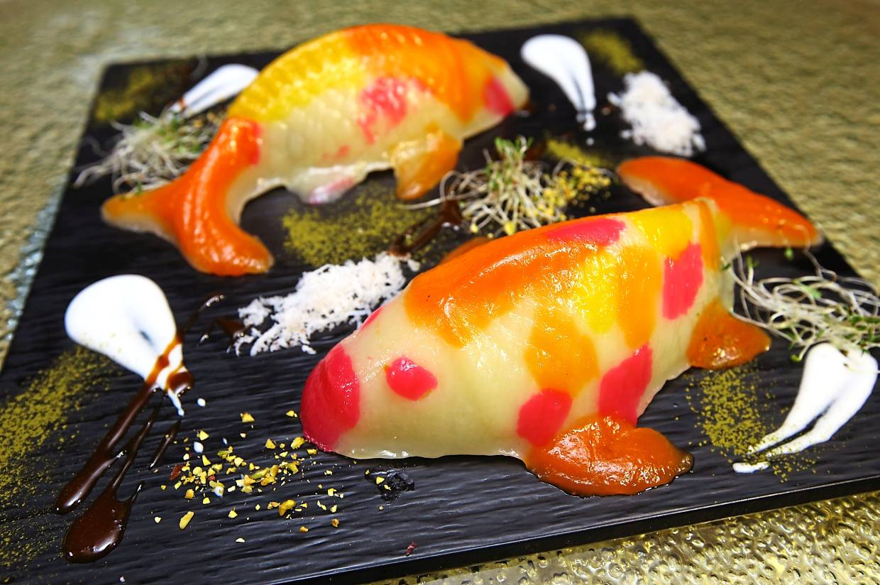 Koi Fish 'Nian Gao' with red bean, coconut cream and coconut flakes.  — Photos: IZZRAFIQ ALIAS/The Star