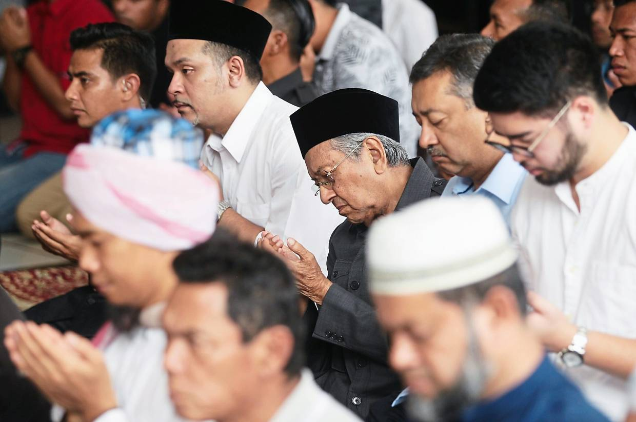 Call to prayer: Dr Mahathir performing the Friday prayers and 'Solat Hajat' at the National Mosque.