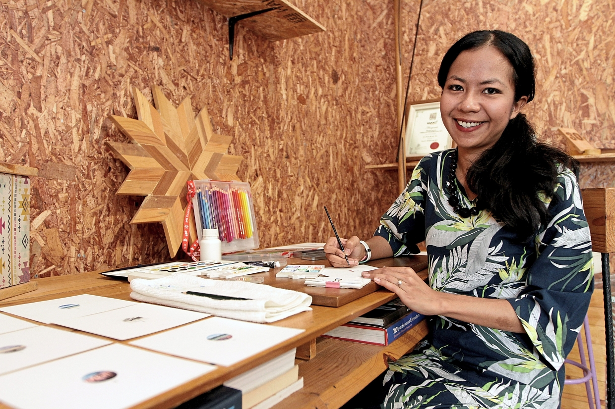 'I never plan what to draw. I just go with the flow. This is how I document my memories, ' says Fariza. Photo: The Star/Yap Chee Hong