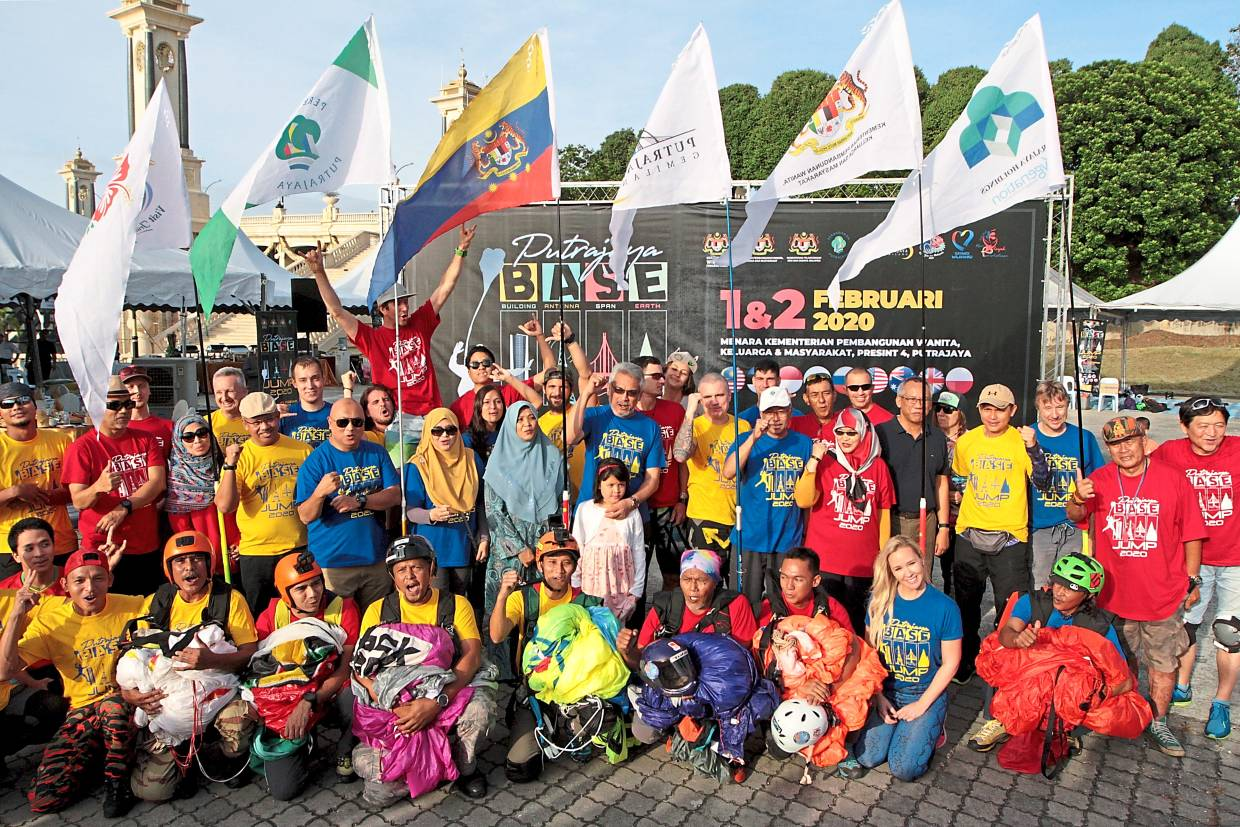 Khalid (centre, in blue) and Aminuddin (standing, fifth from left) with the base jumpers and supporters of the  inaugural Putrajaya Base Jump 2020. — Photos: YAP CHEE HONG/The Star
